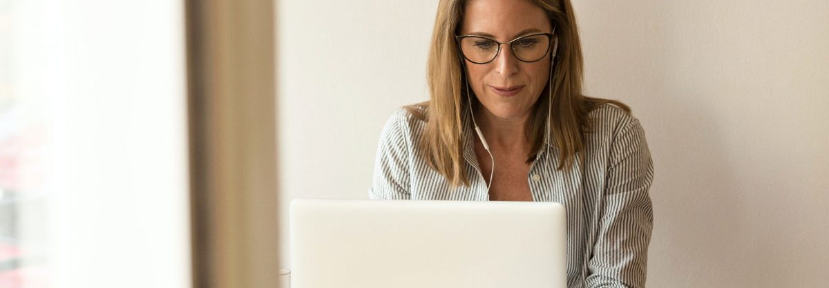 woman using computer wide 1